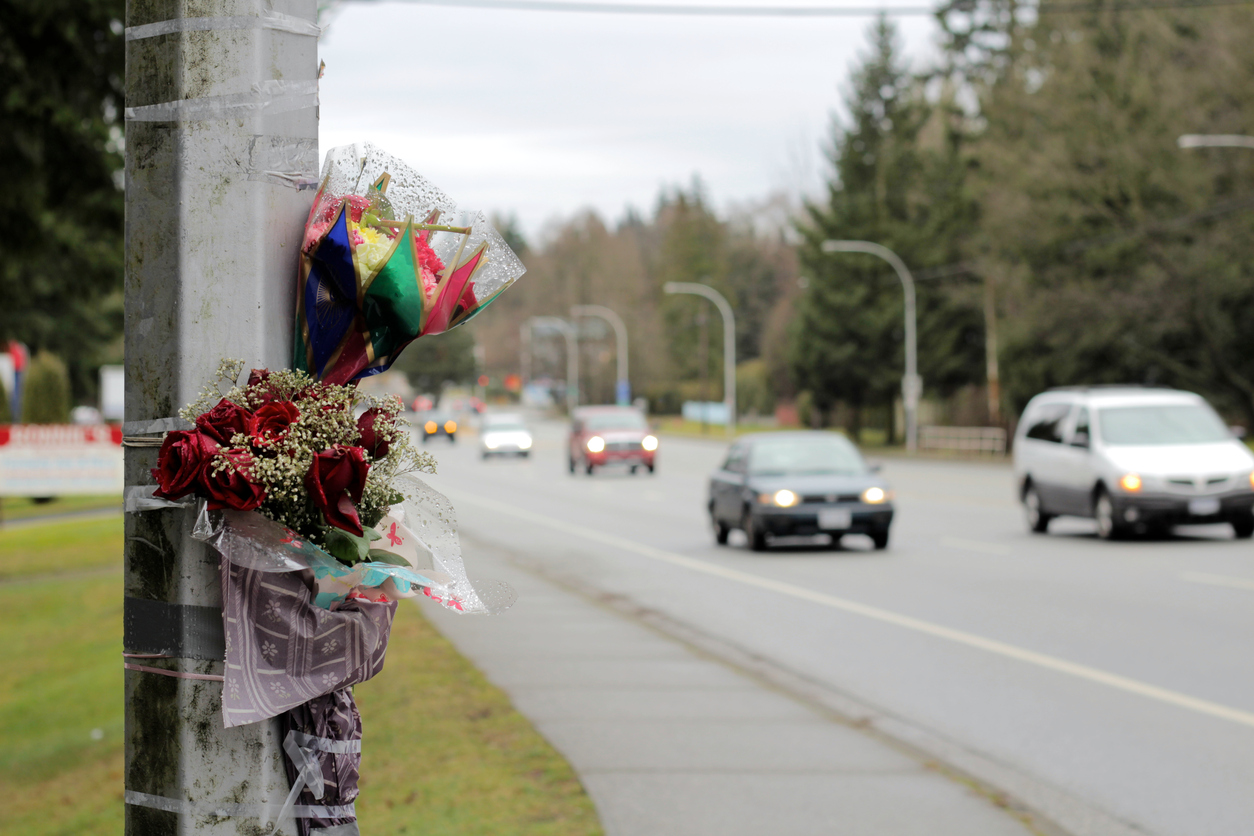 Cars Pass By Roadside Memorial Accident Scene