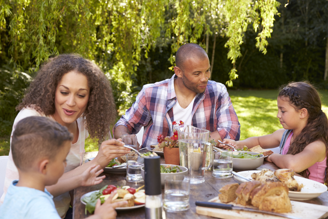 Family Eating Outdoor Meal on Memorial Day